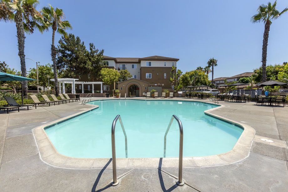 Resort-style swimming pool at Camden Sierra at Otay Ranch apartments in Chula Vista, CA