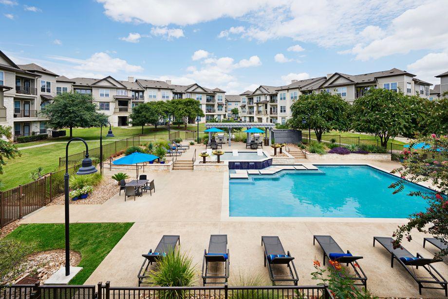 Resort-style swimming pool at Camden Cedar Hills apartments in Austin, TX