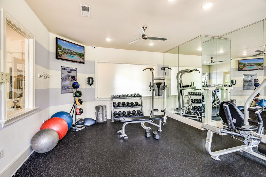 Fitness center with free weights at Camden Governors Village Apartments in Chapel Hill, NC