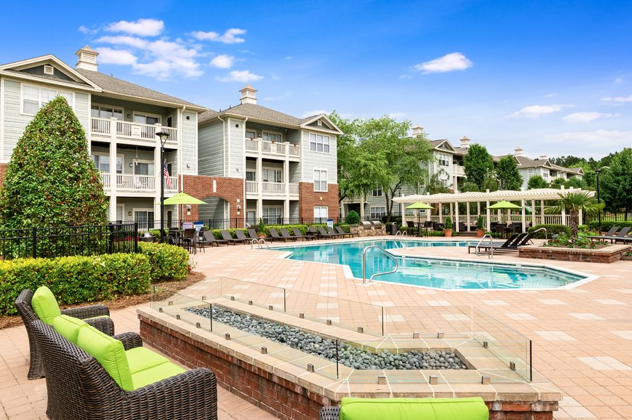 Resort-style swimming pool with outdoor fire place at Camden Governors Village Apartments in Chapel Hill, NC