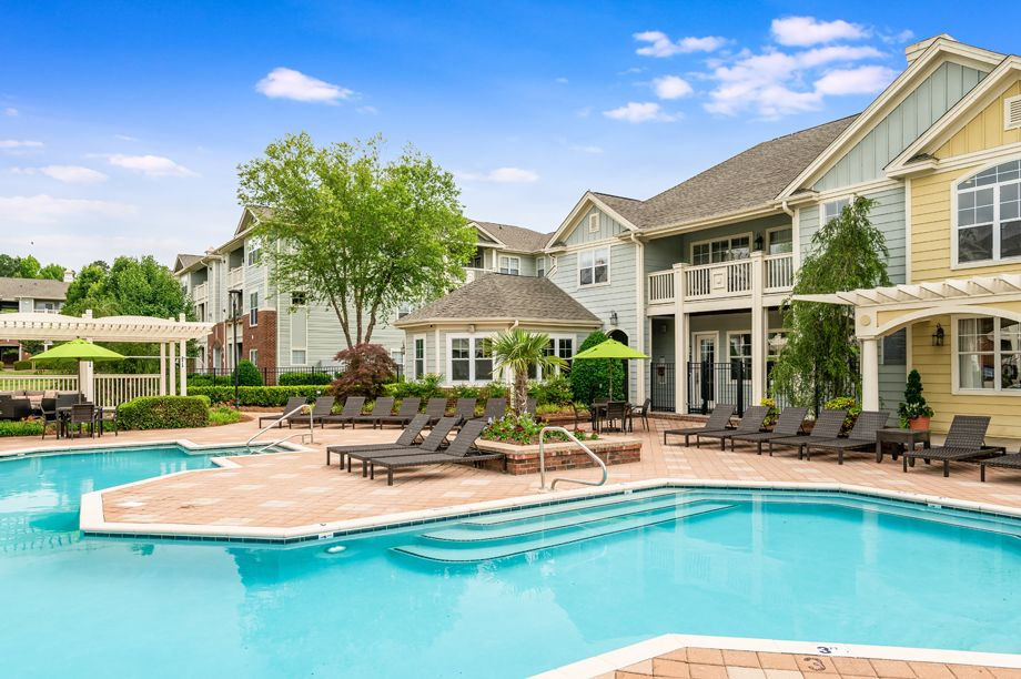 Resort-style swimming pool and clubhouse at Camden Governors Village Apartments in Chapel Hill, NC