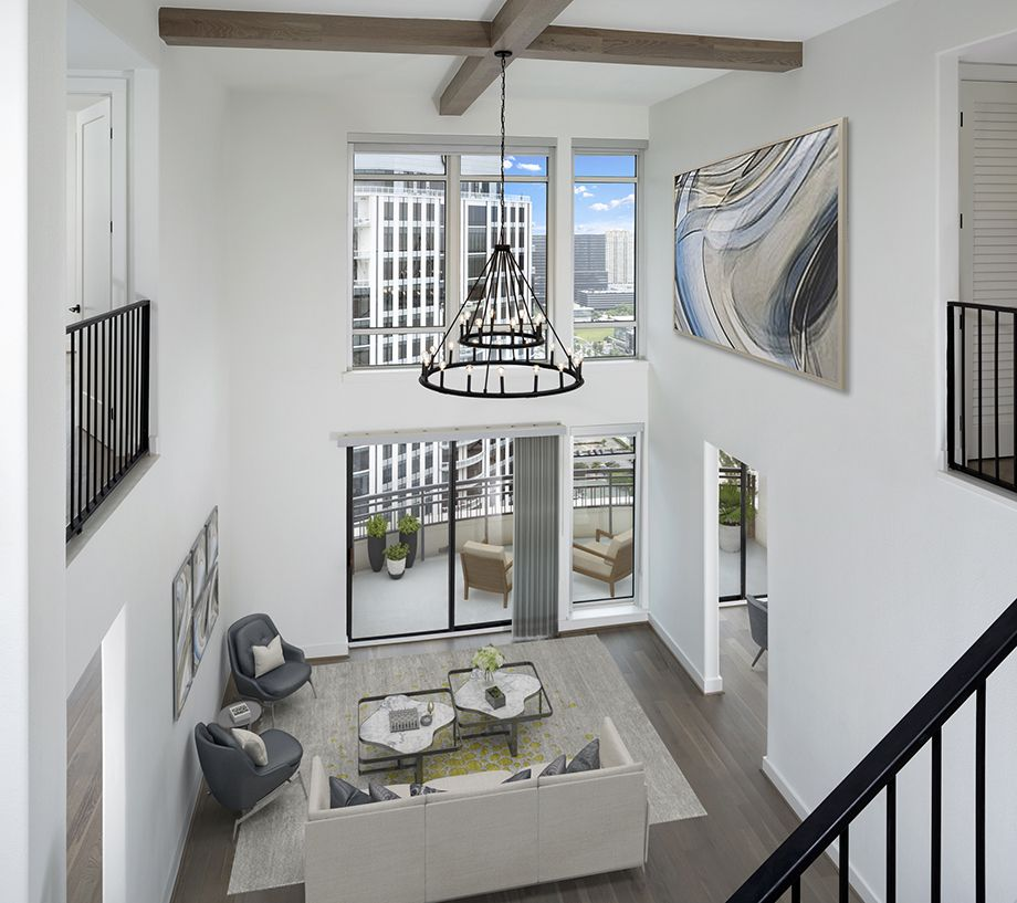 Penthouse Living Area with Floor to Ceiling Windows at Camden Post Oak High Rise Luxury Apartments