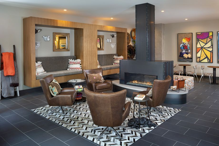 Camden RiNo apartments in Denver, Colorado live work resident lounge with fireplace