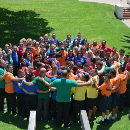 Camden employees enjoying a group hug