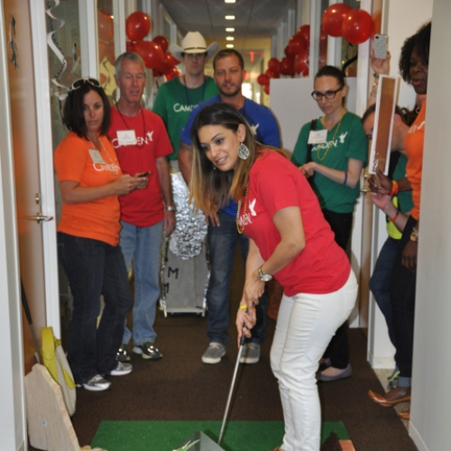Camden employees competing in a miniature golf game at the corporate office in Houston, Texas