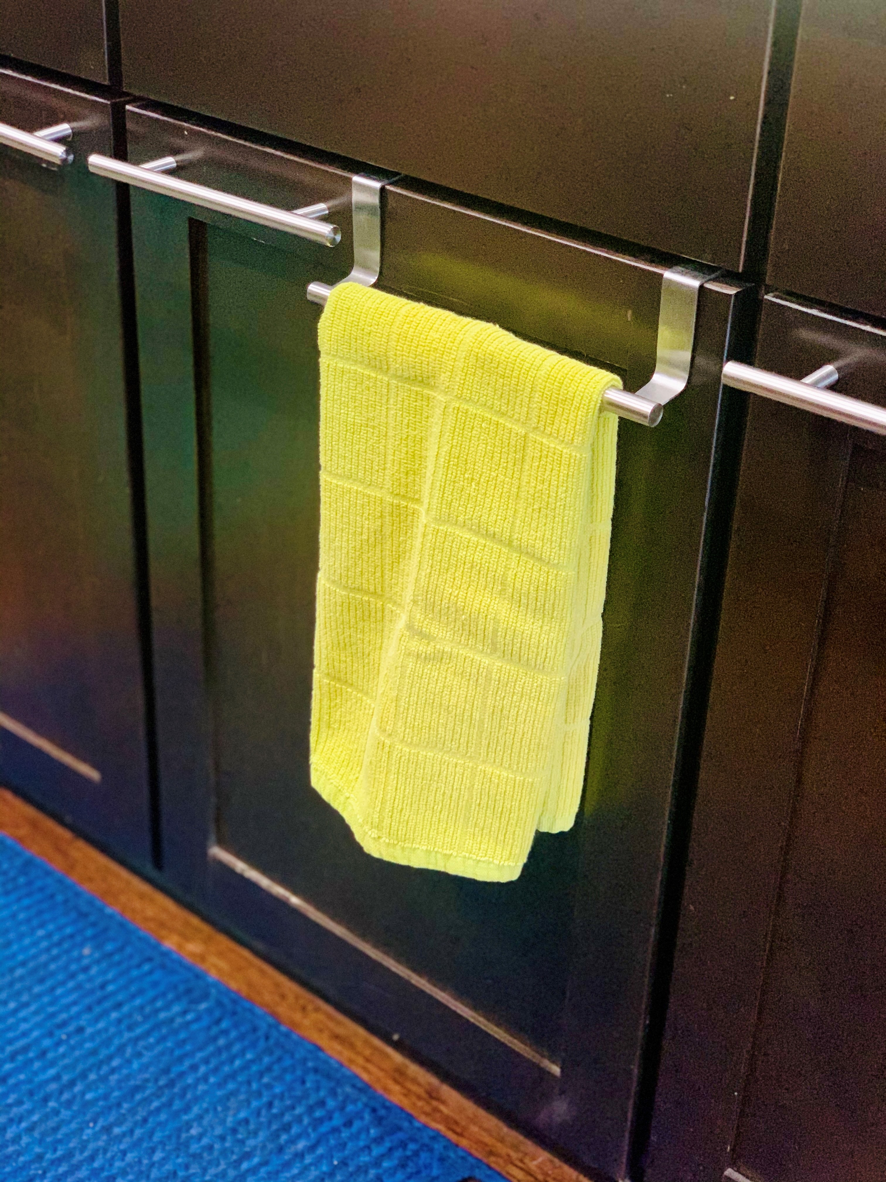 Over-the-door cabinet towel bar